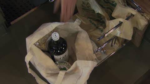 groceries in reusable bag - paper bag stock videos & royalty-free footage