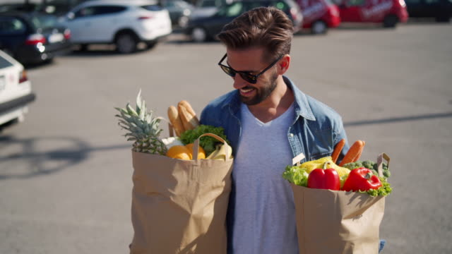 groceries shopping? check - carrying stock videos & royalty-free footage