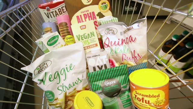 a grocery cart filled by the photographer with vegan food products stands in a veganz vegan grocery store on february 2 2018 in berlin germany veganz... - vegan food stock videos & royalty-free footage