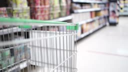Grocery cart Moving through Aisle with blurry background shot, new normal life, stock up on food, shopping items  supply, SLOW MOTION