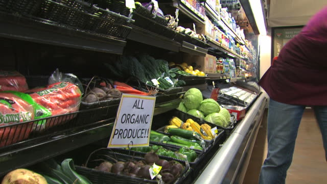 grocery clerk stocking organic vegetables - see other clips from this shoot 1172 stock videos & royalty-free footage