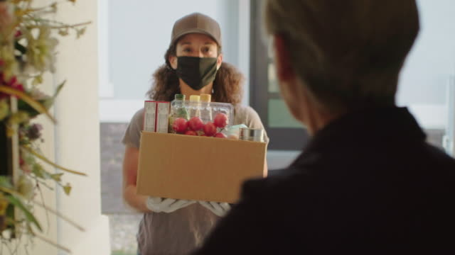 grocery delivery person - coronavirus stock videos & royalty-free footage