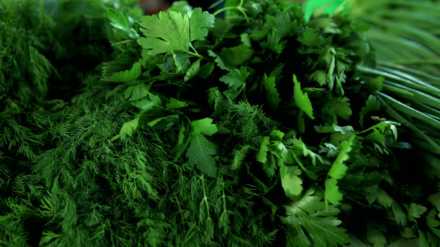 grocery market. bunches of greens at stall - parsley stock videos and b-roll footage