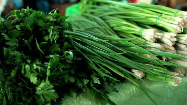 grocery market. bunches of greens at stall - bunch stock videos and b-roll footage