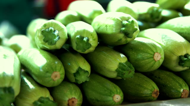 grocery market. heap of zucchini - abundance stock videos & royalty-free footage