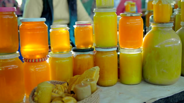 grocery market. honey stall - sticky stock videos & royalty-free footage
