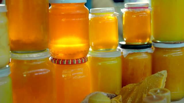 grocery market. honey stall - jar stock videos & royalty-free footage