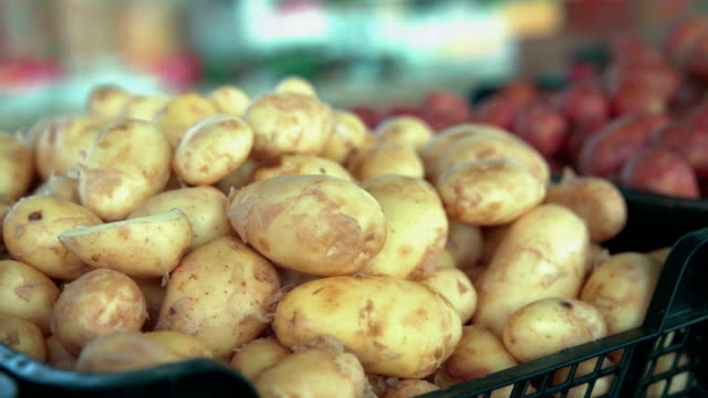 grocery market. raw potato in boxes - yellow stock videos & royalty-free footage