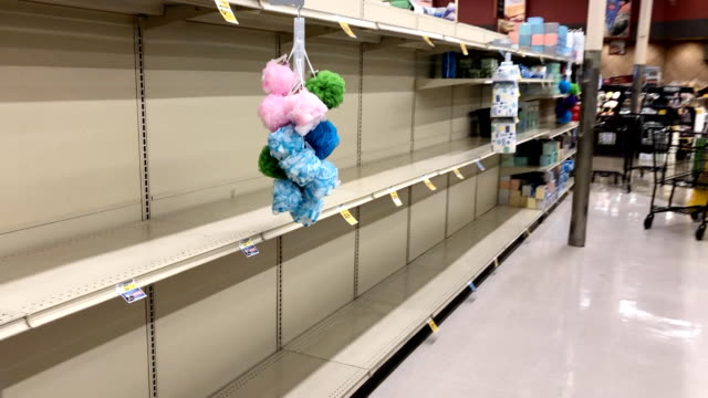 grocery shelves are emptied of toilet paper in southern california during the coronavirus panic. - sold out stock videos & royalty-free footage