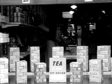 a grocery shop window advertises that tea is now out of rationing - food stamps stock videos & royalty-free footage