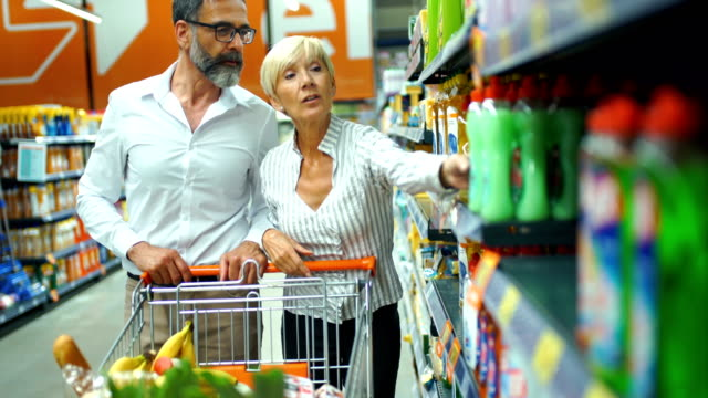 grocery shopping - mid adult women stock videos & royalty-free footage