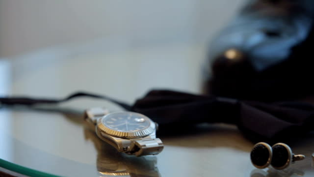 groom accessories watch, bow-tie, cufflinks and shoes - grace stock videos and b-roll footage
