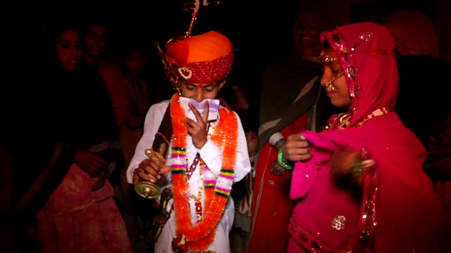 ms td groom and bride at their wedding ritual / rajasthan, india - verheiratet stock-videos und b-roll-filmmaterial
