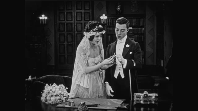 1920 groom (buster keaton) and bride prepare for wedding ceremony - married stock videos & royalty-free footage