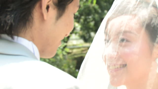 cu groom and bride smiling at each other - 結婚式点の映像素材/bロール