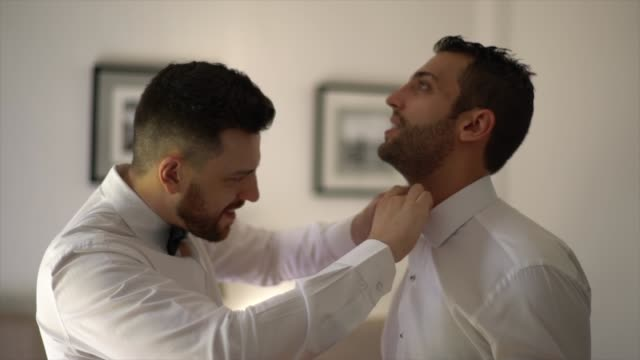 groom and groomsman getting dressed for the weeding - full suit stock videos & royalty-free footage