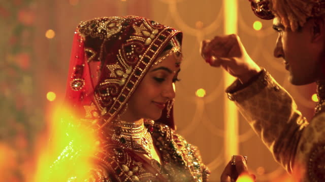 Groom applying sindoor on his wife forehead