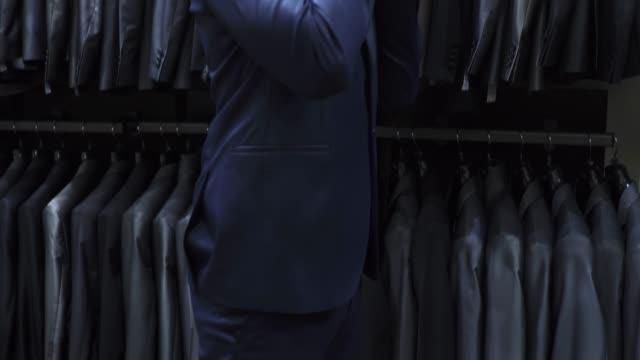 groom choosing his wedding attire - dinner jacket stock videos & royalty-free footage