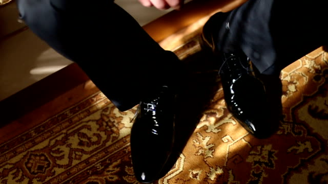 groom dressing up with classic elegant shoes - leather shoe stock videos and b-roll footage