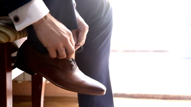 groom dressing up with classic elegant shoes. - completo video stock e b–roll