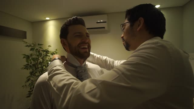 groom getting dressed with the help of his best friend for his wedding - bridegroom stock videos & royalty-free footage