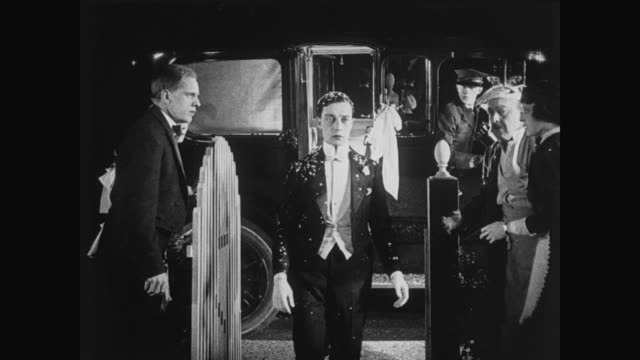 1920 groom (buster keaton) greeted by rice throwing friends who don't realize there is no bride - exclusion stock videos & royalty-free footage