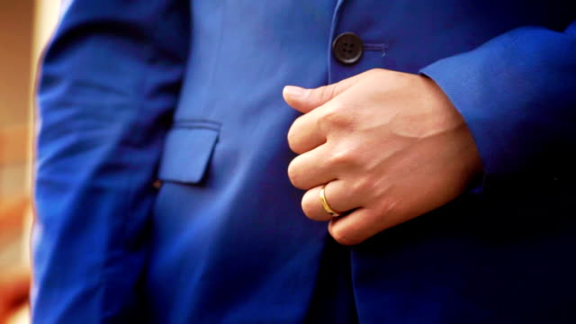 Groom in Navy blue suit.