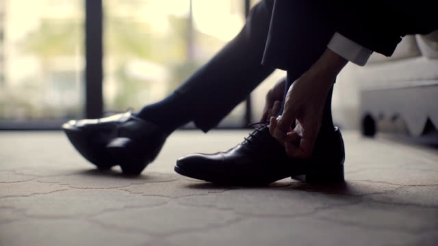 groom is getting ready for event - footwear stock videos & royalty-free footage