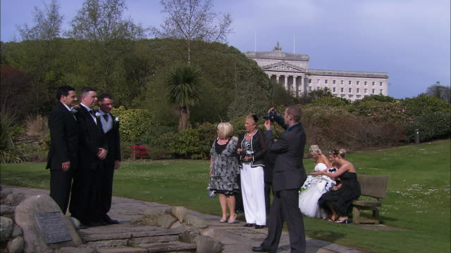groom photographed in park, stormont castle in background, northern ireland - medium group of objects stock videos & royalty-free footage