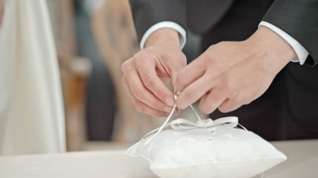 SLO MO Groom placing ring on bride's finger