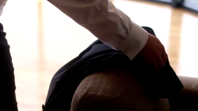 groom putting on suit jacket - suit jacket stock videos & royalty-free footage