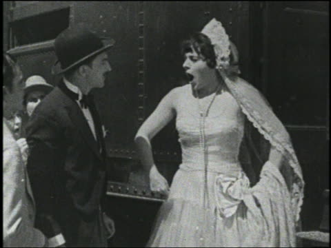 b/w 1928 groom slaps bride, she slaps him back, they start fighting - bride stock videos and b-roll footage