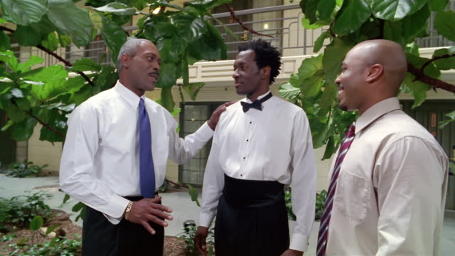 groom talking to father and best man on wedding day - best man stock videos and b-roll footage