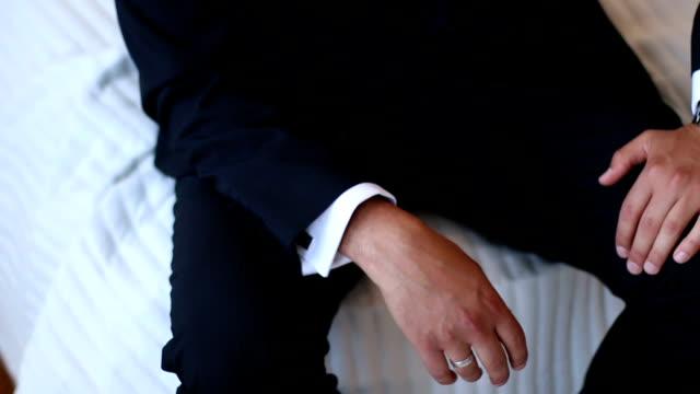 Groom wearing a new watch in the wrist
