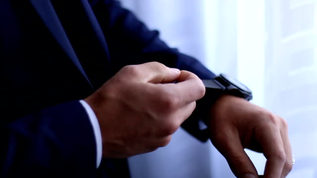 groom wearing a new watch in the wrist - checking the time stock videos & royalty-free footage