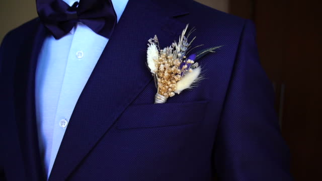 Groom wearing Boutonniere on the suit