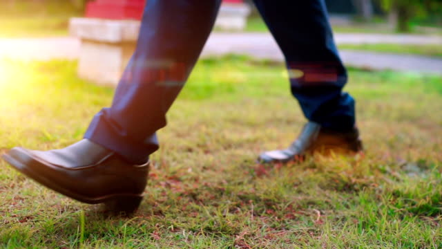 groom with elegant shoes, focus to foot walk steep. - leather shoe stock videos and b-roll footage
