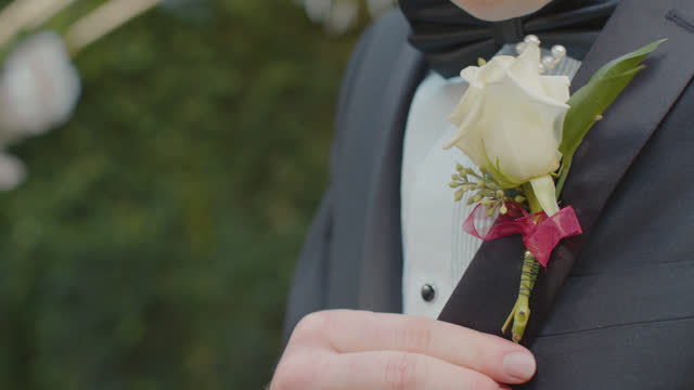 cu groomsman fixes his boutonniere - adjusting stock videos & royalty-free footage