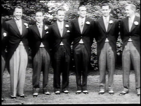 Groomsmen and parents posing as Martha Firestone daughter of the tire company head and William Ford grandson of Henry Ford are about to marry / Akron...