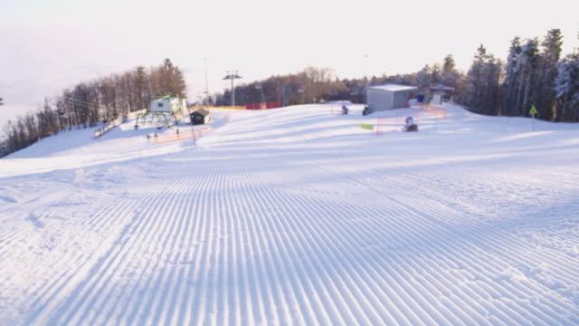 4K Grooves in plowed snowy ski slope, real time