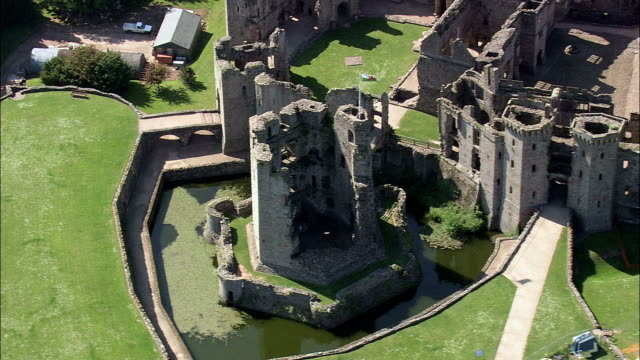 grosmont castle  - aerial view - wales,  monmouthshire,  grosmont helicopter filming,  aerial video,  cineflex,  establishing shot,  united kingdom - wales stock videos & royalty-free footage
