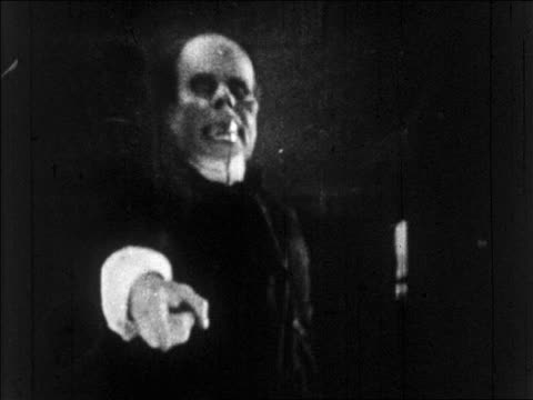 b/w 1925 grossly disfigured man (lon chaney, sr.) pointing to camera / feature - 1925 stock videos & royalty-free footage