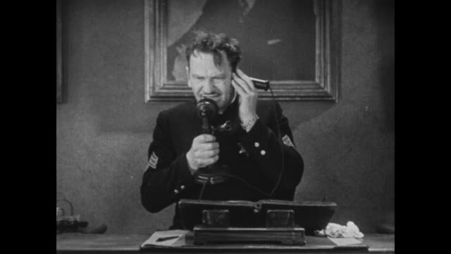 1931 Grouchy sergeant Wallace Beery answers emergency calls as Buster Keaton attempts to direct other police officers