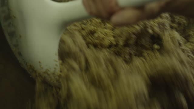 vídeos de stock, filmes e b-roll de ground barley pushed into bucket - cereal plant