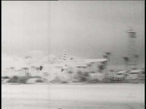 ground control pilots transfer control of b-17 drones to a mother aircraft during operation crossroads. - bikini atoll stock videos & royalty-free footage