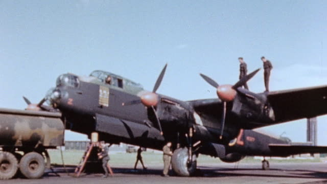 ground crew and fuel truck servicing parked raf lancaster heavy bomber - lancaster bomber stock videos & royalty-free footage