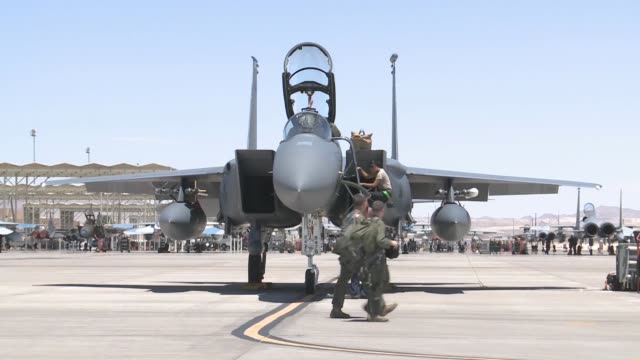 vídeos de stock, filmes e b-roll de ground crew members work on an f15e strike eagle assigned to the 336th fighter squadron 4th fighter wing at seymourjohnson air force base nc during... - nellis air force base