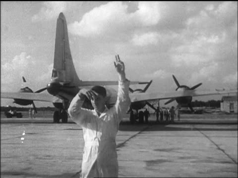 b/w 1947 ground crewman giving signal on airfield for airplane / california / newsreel - 1947 stock videos and b-roll footage