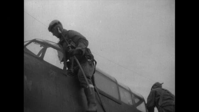 ground crews carry bombs to an air field then receive instruction before taking off pilots fly army type 89 light bombers and drop bombs where enemy... - battleship stock videos & royalty-free footage