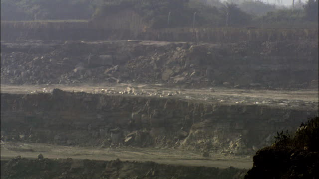 ws ground exploding at coal mine operation and forming dust cloud / india - coal mine stock videos & royalty-free footage